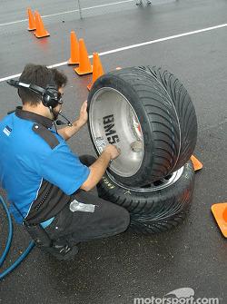 Crew member prepares wheels