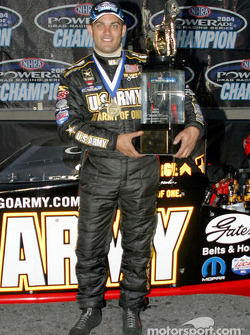 Tony Schumacher with his championship trophy