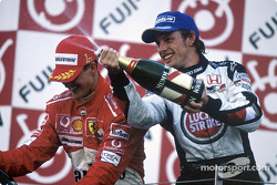 Podium: champagne for Michael Schumacher and Jenson Button
