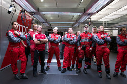 Audi Sport team members watch qualifying
