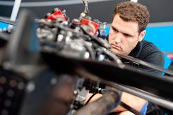 A Ocean Racing Technology mechanic works on Max Chilton car
