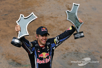 Race winner Sebastian Vettel, Red Bull Racing with his team