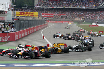 Lewis Hamilton, McLaren Mercedes and Mark Webber, Red Bull Racing at the start