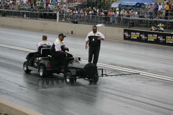 NHRA Officals spray chemicals on the track to improve traction