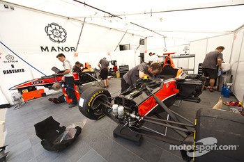 Mechanics work in the Manor garage on the cars of Adrien Tambay, Rio Haryanto and Adrian Quaife-Hobbs