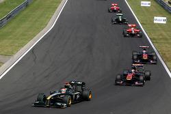Jarno Trulli, Lotus F1 Team leads Sebastien Buemi, Scuderia Toro Rosso