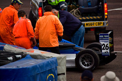 Carlos Huertas car is recoverd after he buries it in the tyre wall