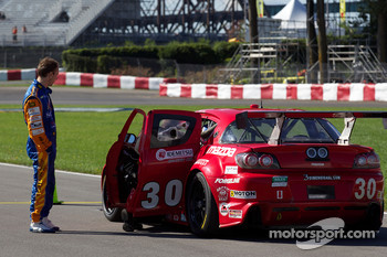 Max Angelelli has a look at the #30 Racers Edge Motorsports Mazda RX-8: Dave Lacey, Jordan Taylor