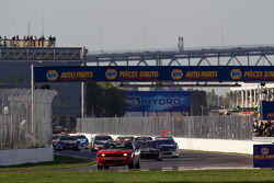 Safety car leads the field under a late race caution