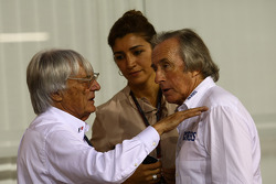 Bernie Ecclestone with Fabiana Flosi girlfriend of Bernie Ecclestone and Sir Jackie Stewart, RBS Representitive and Ex F1 World Champion