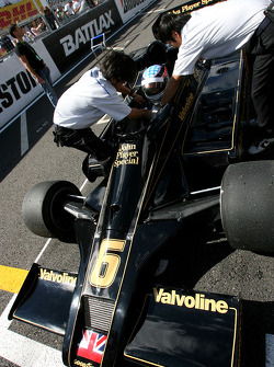 Takuma Sato drives the 1976 Lotus Ford of Gunnar Nilson