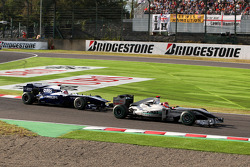 Michael Schumacher, Mercedes GP leads Rubens Barrichello, Williams F1 Team