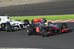 Lewis Hamilton, McLaren Mercedes and Kamui Kobayashi, BMW Sauber F1 Team