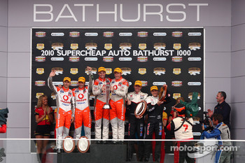 Podium: Jamie Whincup, Steve Owen, #1 TeamVodafone take second, Craig Lowndes, Mark Skaife, #888 TeamVodafone take first and Garth Tander, Cameron McConville, #2 Toll Holden Racing Team take third