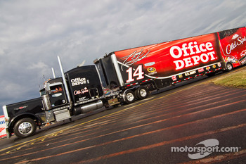 The Office Depot hauler pulls into the track