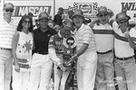 Victory lane: race winner Tim Richmond celebrates