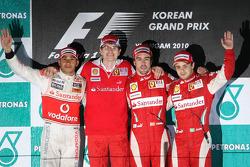 Podium: race winner place Fernando Alonso, Scuderia Ferrari, second place Lewis Hamilton, McLaren Mercedes, third place Felipe Massa, Scuderia Ferrari, and Chris Dyer, Scuderia Ferrari, Track Engineer of Fernando Alonso