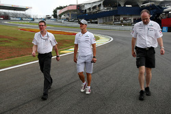 Michael Schumacher, Mercedes GP walks the track Andrew Shovlin, Mercedes GP, Senior Race Engineer to Michael Schumacher