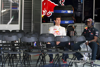 Mark Webber, Red Bull Racing sits quietly in his garage while his car is on the grid
