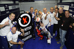 Race winner and 2010 MotoGP champion Jorge Lorenzo, Fiat Yamaha Team celebrates with his team
