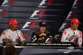 Press conference: race winner and 2010 Formula One World Champion Sebastian Vettel, Red Bull Racing, second place Lewis Hamilton, McLaren Mercedes, third place Jenson Button, McLaren Mercedes