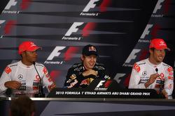 Press conference: race winner and 2010 Formula One World Champion Sebastian Vettel, Red Bull Racing, second place Lewis Hamilton, McLaren Mercedes, third place Jenson Button, McLaren Mercedes