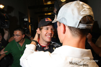 Michael Schumacher, Mercedes GP congratulates Sebastian Vettel, Red Bull Racing