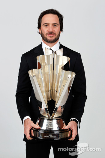 Five-time champion Jimmie Johnson poses with the Sprint Cup trophy