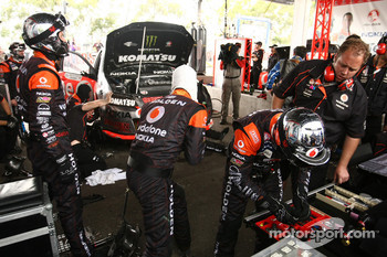 Team mechanics work on the car of Jamie Whincup, #1 TeamVodafone
