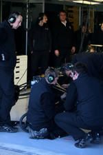 Team Lotus mechanics working on the car
