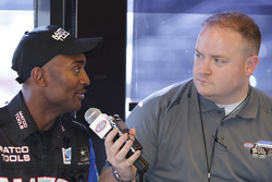 Antron Brown (left) being interviewed by NHRA Media Relations Manager Zach Elcock