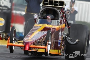 James Butler launching hard while his supercharger pulley spins in front of his 2002 Hadman Dragster