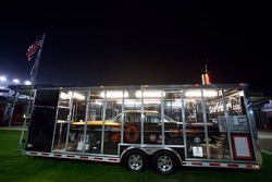 The winning car of the 1961 Daytona 500 sits alone in the fanzone at night