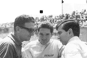 Pedro and Ricardo Rodrguez at Le Mans confering with Eugenio Dragoni, Ferrari's team manager. Pedro is facing the camera, Ricardo gives his left profile.