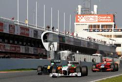 Adrian Sutil, Force India, Heikki Kovalainen, Team Lotus and Jerome d'Ambrosio, Virgin Racing