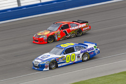 David Reutimann, Michael Waltrip Racing Toyota and Jamie McMurray, Earnhardt Ganassi Racing Chevrolet