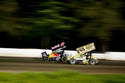 Joey Saldana and Chad Kemenah battle down the back straight