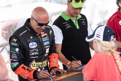 Tim Coronel and Erik van Loon signs autographs for the fans