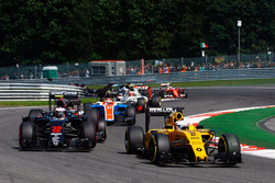 Kevin Magnussen, Renault Sport F1 Team RS16 leads Jenson Button, McLaren MP4-31 as he is hit by Pascal Wehrlein, Manor Racing MRT05 at the start of the race
