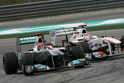 Michael Schumacher, Mercedes GP and Kamui Kobayashi, Sauber F1 Team