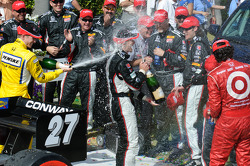 Mike Conway gets a champagne shower from Ryan Briscoe and Dario Franchitti
