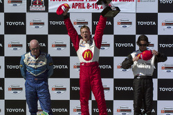 Podium: race winner Sébastien Bourdais with Paul Tracy and Bruno Junqueira