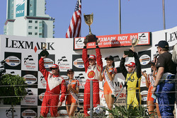 Podium: race winner and Champ Car World Series 2005 champion Sébastien Bourdais with A.J. Allmendinger and Jimmy Vasser