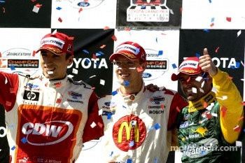 Podium: race winner Sbastien Bourdais with Justin Wilson and Alex Tagliani
