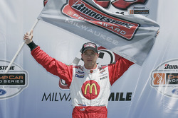 Podium: Race winner Sébastien Bourdais celebrates