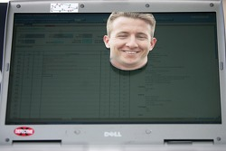 The face of A.J. Allmendinger on a monitor