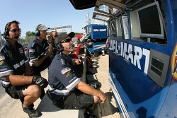 Mi-Jack Conquest Racing crew members watch Andrew Ranger on the monitors