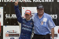 Victory podium: A.J. Allmendinger and Neil Micklewright
