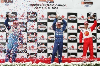 Podium: race winner A.J. Allmendinger with Paul Tracy and Sbastien Bourdais