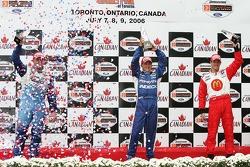 Podium: race winner A.J. Allmendinger with Paul Tracy and Sébastien Bourdais